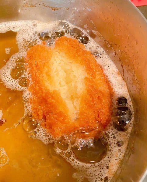 Donut frying in hot oil.