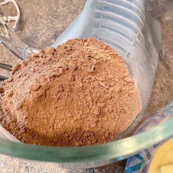 One dark chocolate fudge cake mix in mixing bowl of mixer