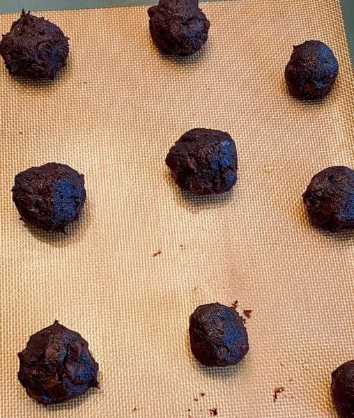 Chocolate Cookie Dough rolled into balls on a baking sheet.