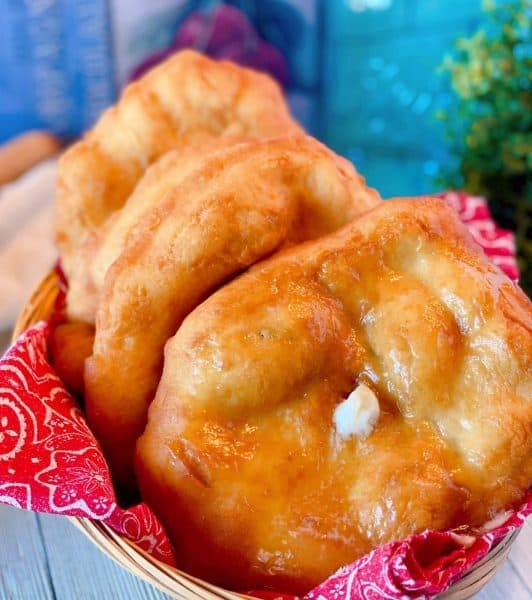 Basket full of Indian Fry bread with butter and honey.