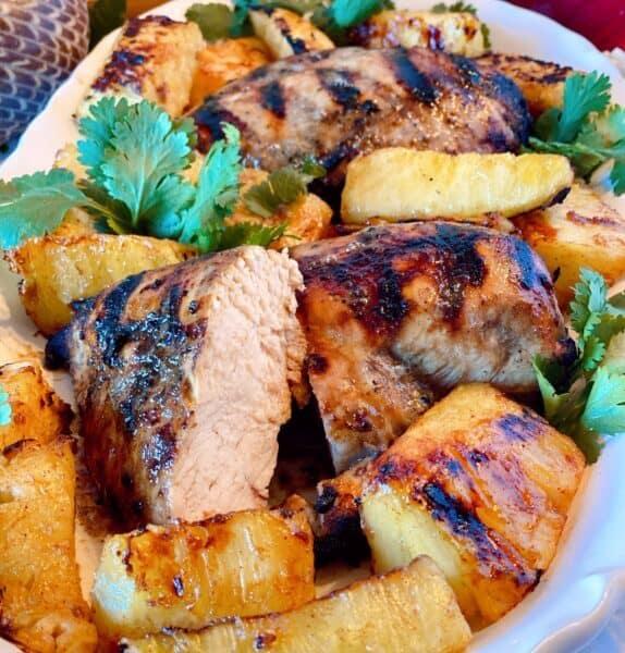 Platter full of Jerk Chicken and pineapple ready to eat!