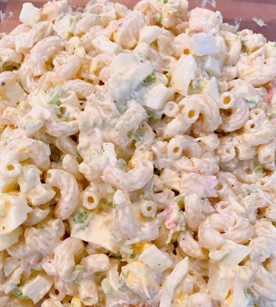 Seafood Macaroni Salad mixed in a bowl and ready to chill in the refrigerator.
