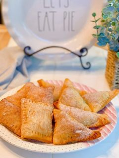 Plate filled with homemade fresh peach hand pies