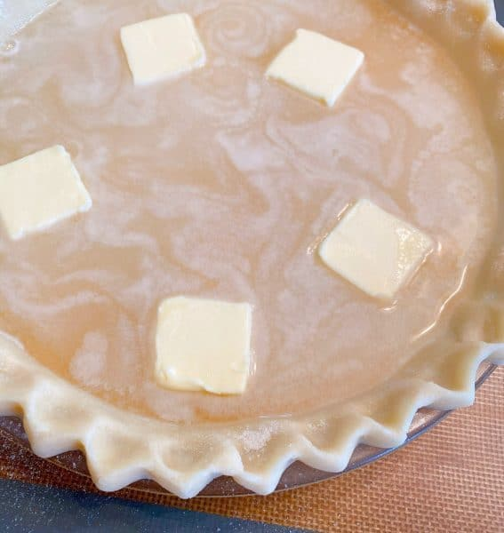 Pats of butter in water pie filling