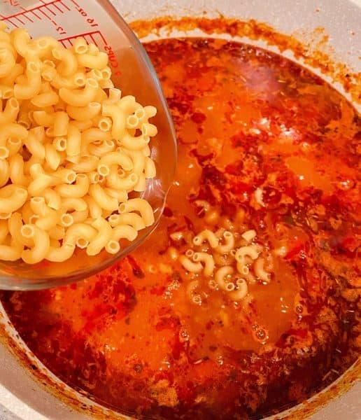 Adding elbow pasta to Goulash mixture