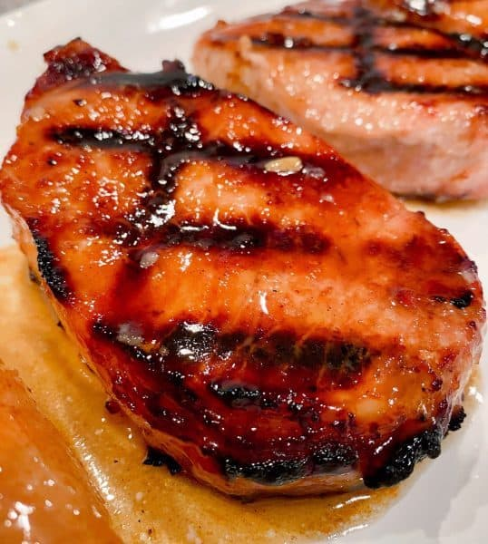 Close up of a grilled pork chop.