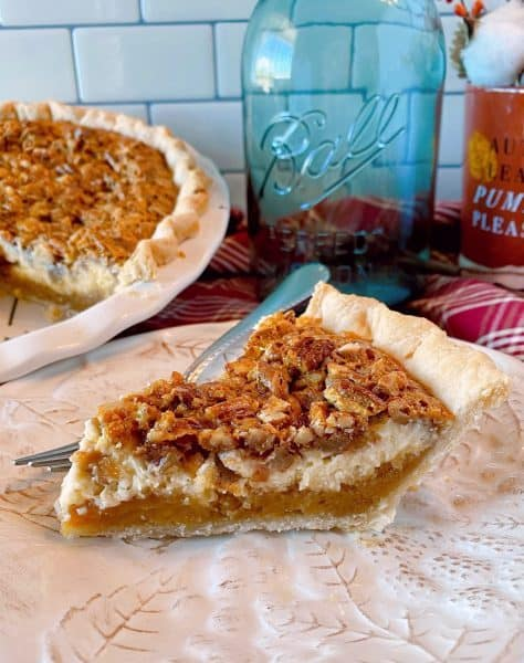Pecan Caramel Cheesecake Pie on a plate ready to eat.
