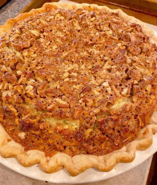 Baked Pecan Caramel Cheesecake Pie.