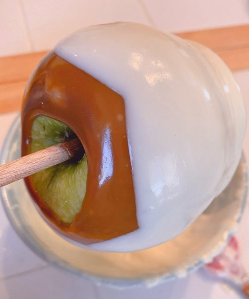 Dipping apples in melted white chocolate