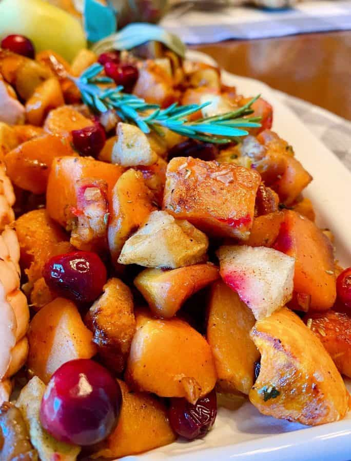 Platter with roasted butternut squash, cranberries, and apples.