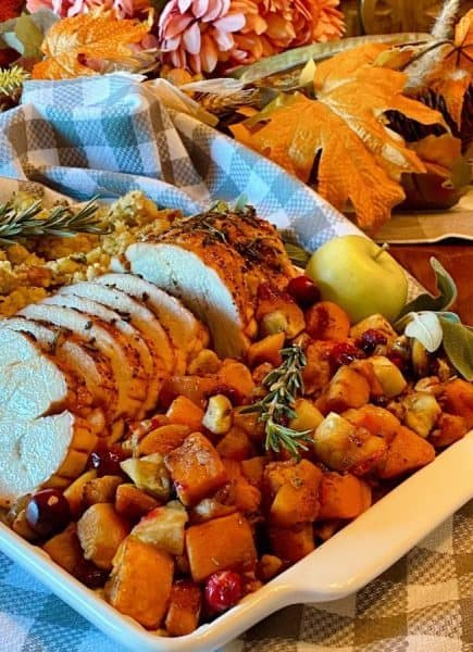 Roasted Butternut with Herb Crusted Pork on a platter.