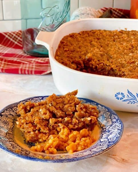 Sweet Potato Pecan Casserole in the casserole dish and a plate full of the casserole.