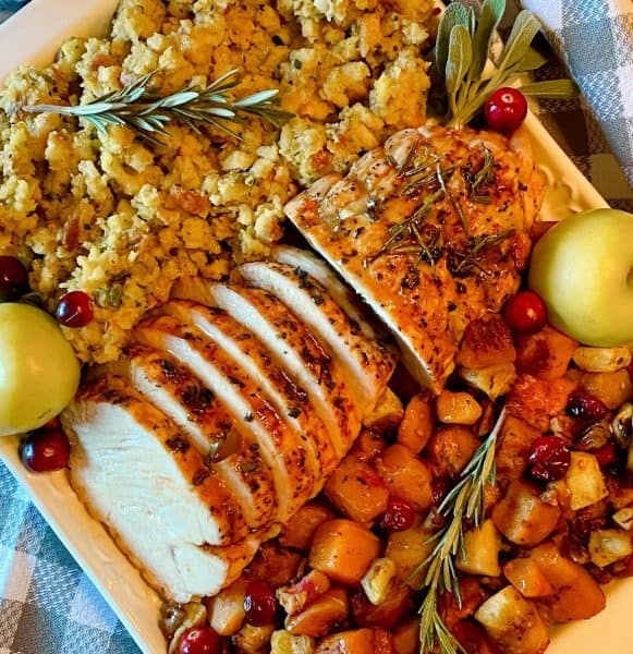 Over head photo of sliced roast with stuffing and butternut squash.