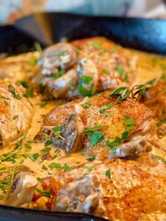 Skillet full of Chicken Thighs in Mushroom Cream Sauce