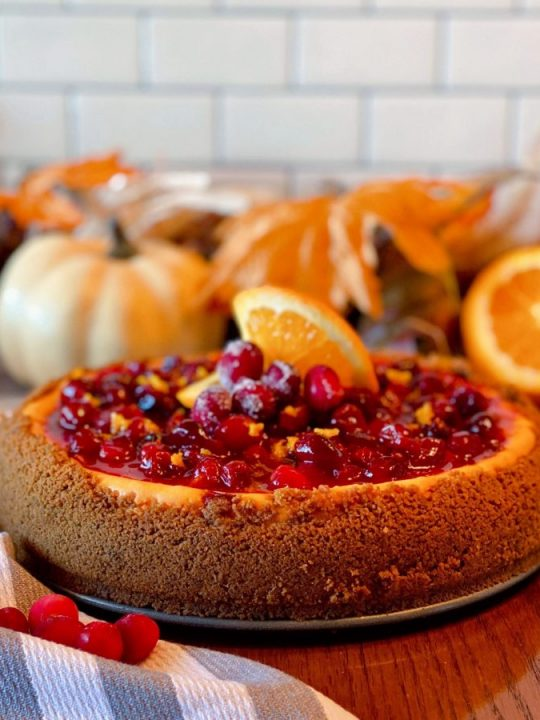 Cranberry Orange Cheesecake with Fall background