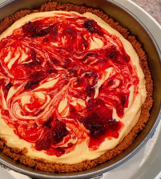 Cranberry filling swirled into cheesecake batter