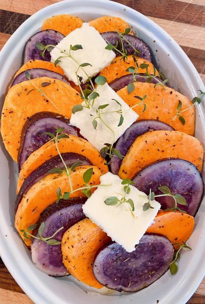 Potatoes and Sweet Potatoes in baking dish ready for baking.