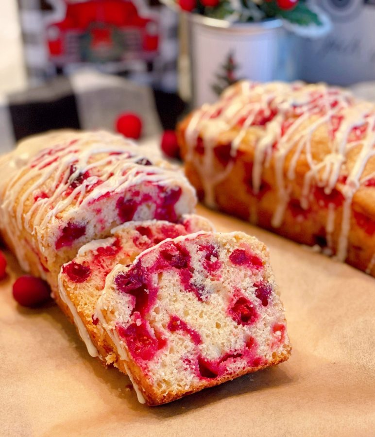 Cranberry Eggnog Bread on a board sliced
