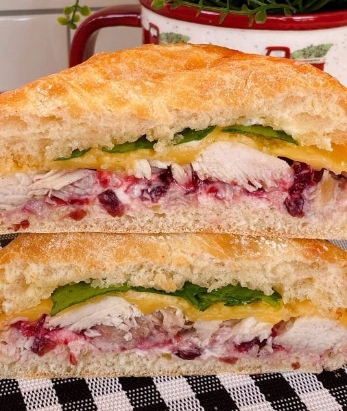 Hot Turkey Sandwich with Cranberry Sauce cut in half and stacked.