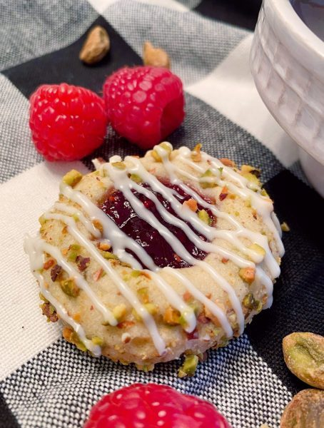 Raspberry Pistachio Cookie close up with white chocolate drizzle