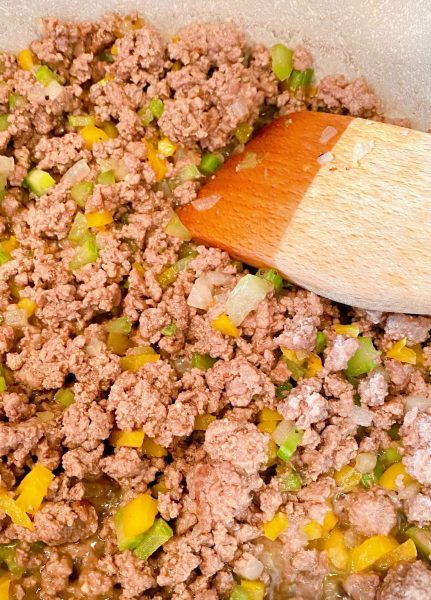Ground Beef in skillet cooked.