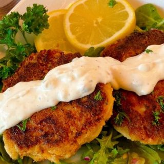 Lump Crab Cakes with Tartar sauce on a bed of arugula