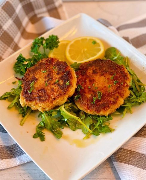 Crab Cakes on a bed of Arugula with a citrus vinaigrette