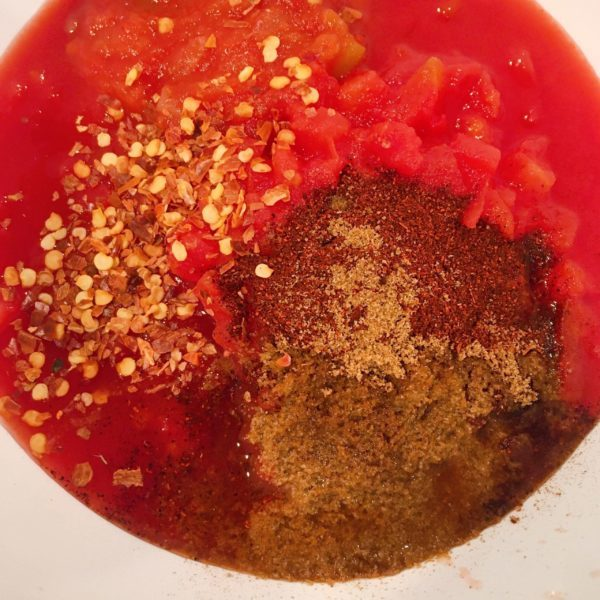 Bowl with red sauce ingredients ready to be combined.
