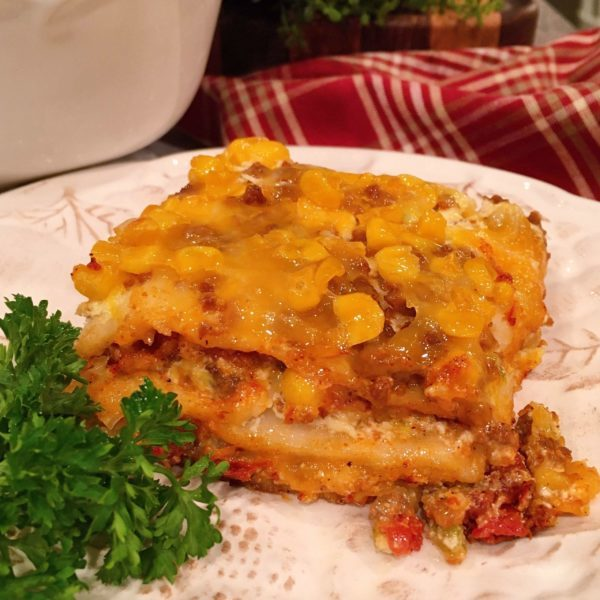 Layered Mexican Lasagna on a plate.
