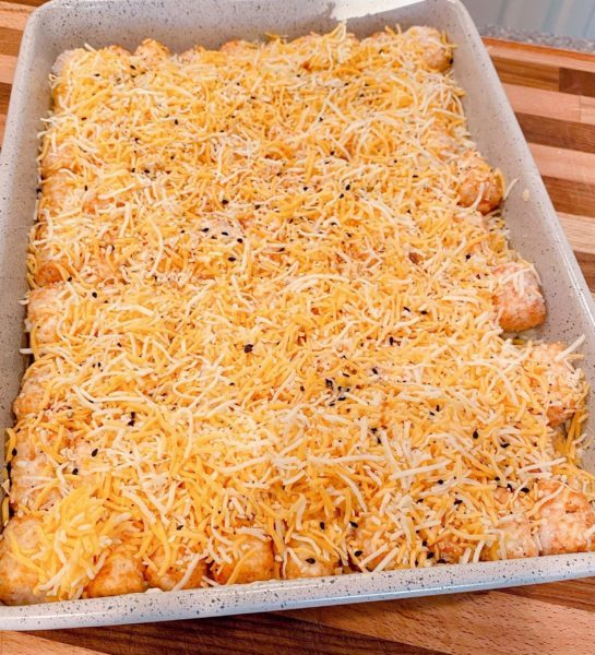 Topping Casserole with grated cheese