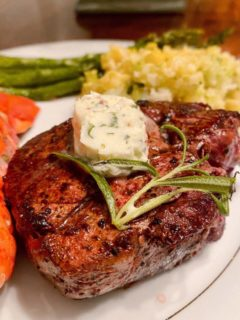 Pan-seared Filet Mignon with Herbed Butter on a serving plate.