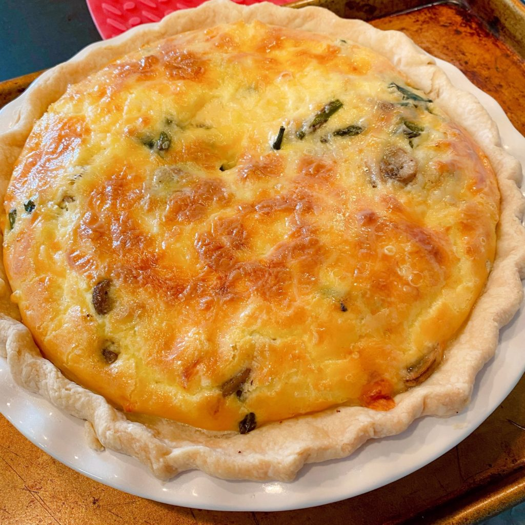 Baked quiche removed from oven and cooling.