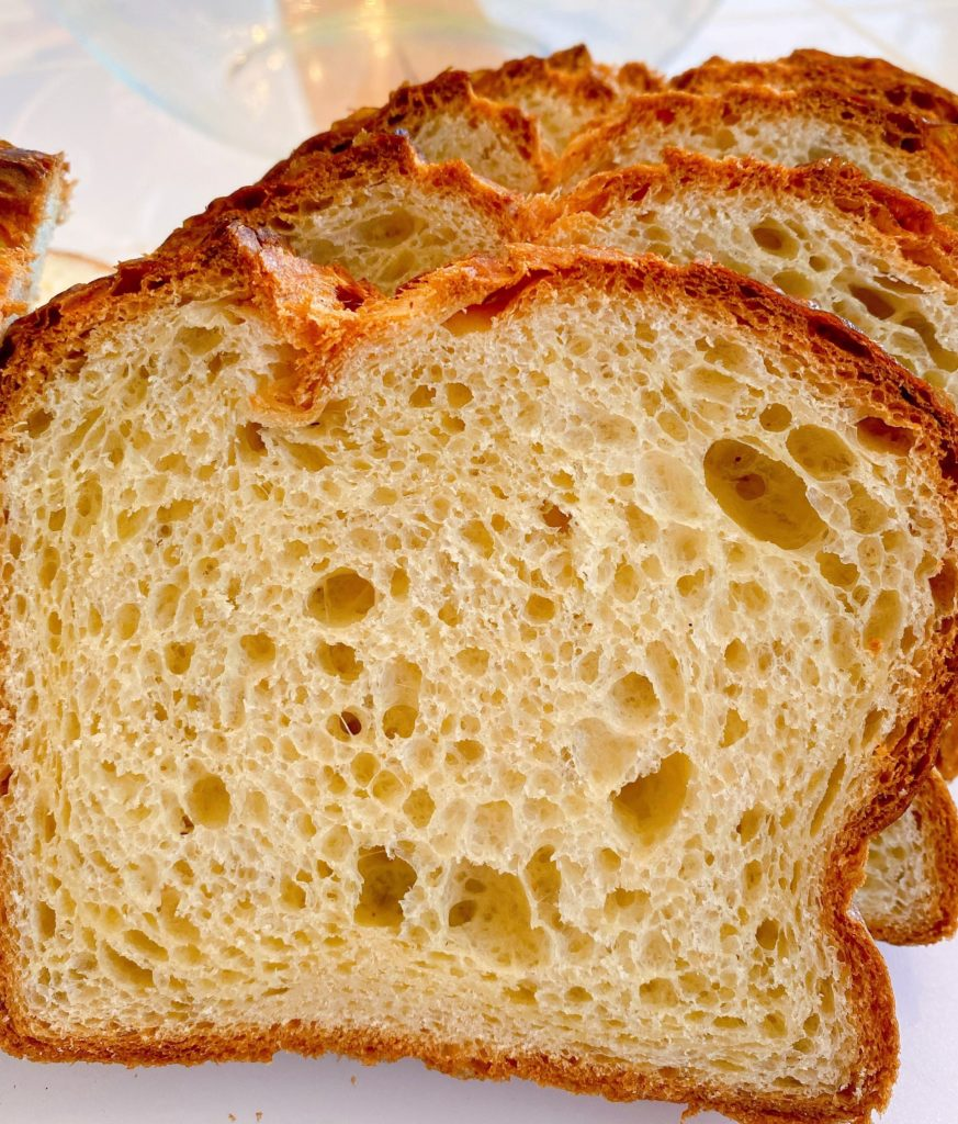 Sliced brioche bread on a cutting board.