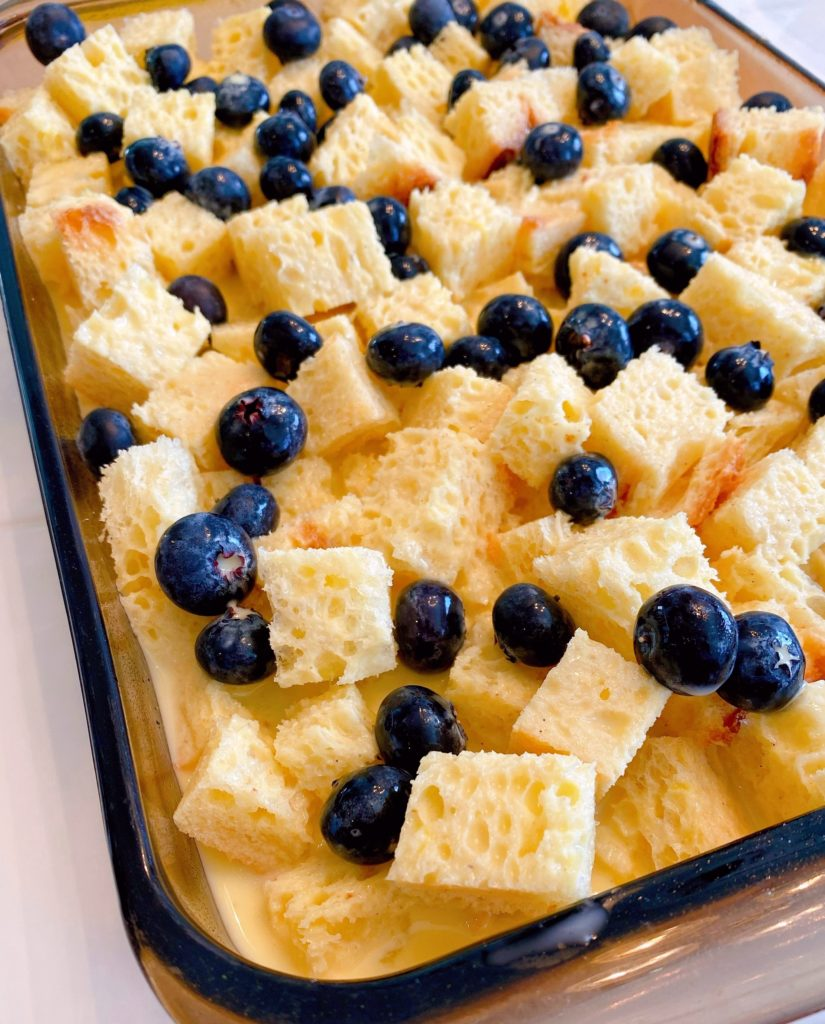 Batter added to bread cubes and blueberries.