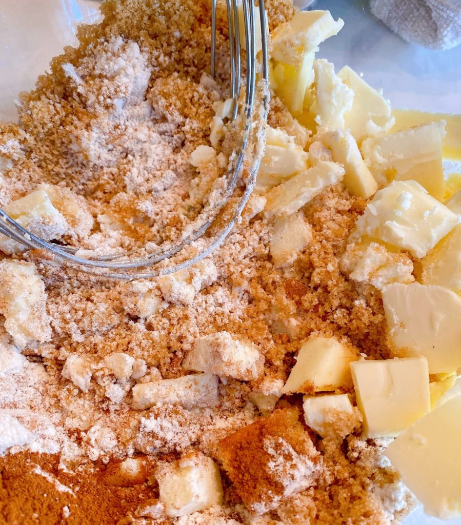 Crumb topping ingredients in a medium bowl with a pastry blender.