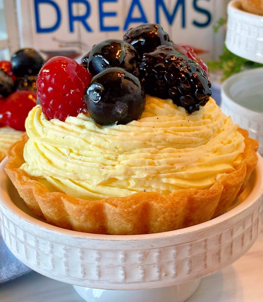 Fresh Fruit Mini Tartlet on a cupcake stand.