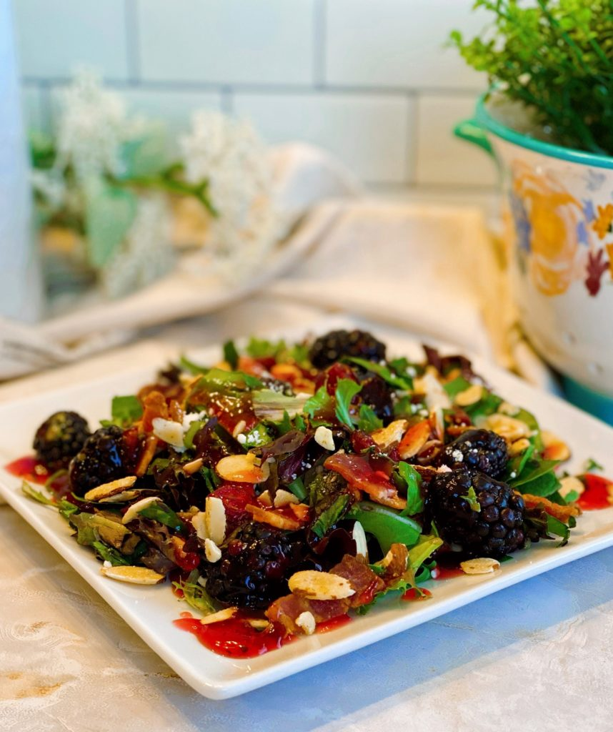 Berry Feta Salad with dressing on a single salad plate.