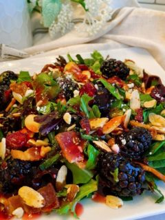 Blackberry Feta Spring Salad with Raspberry Vinaigrette Dressing on a salad plate.