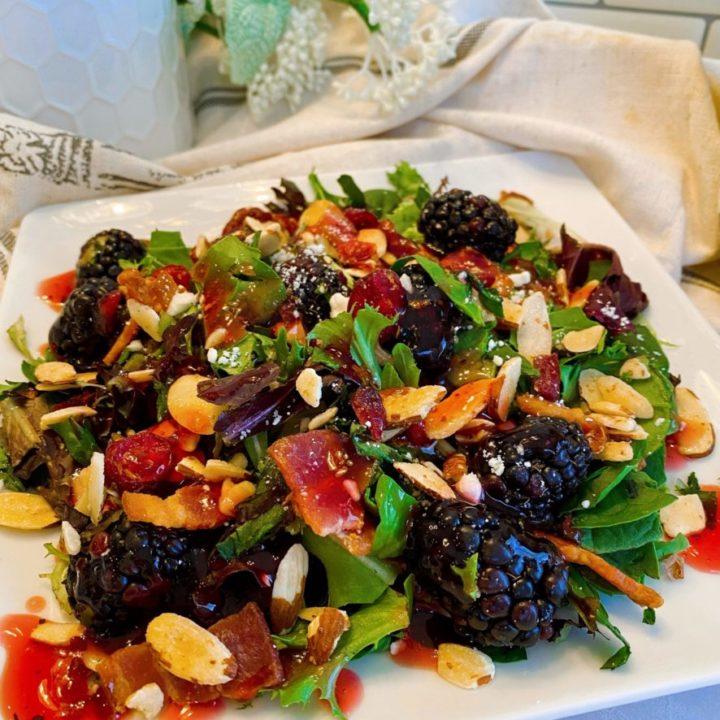 Blackberry Feta Spring Salad with Raspberry Vinaigrette Dressing on a salad plate.