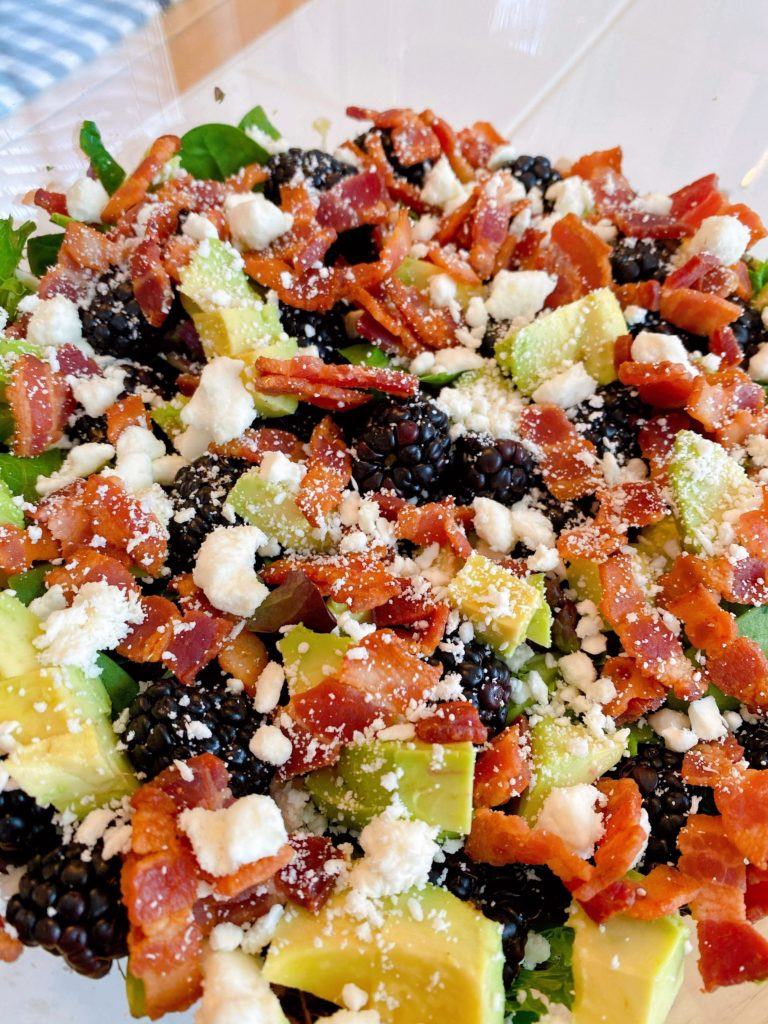 Feta Cheese sprinkled over top of berries, avocados, and bacon.