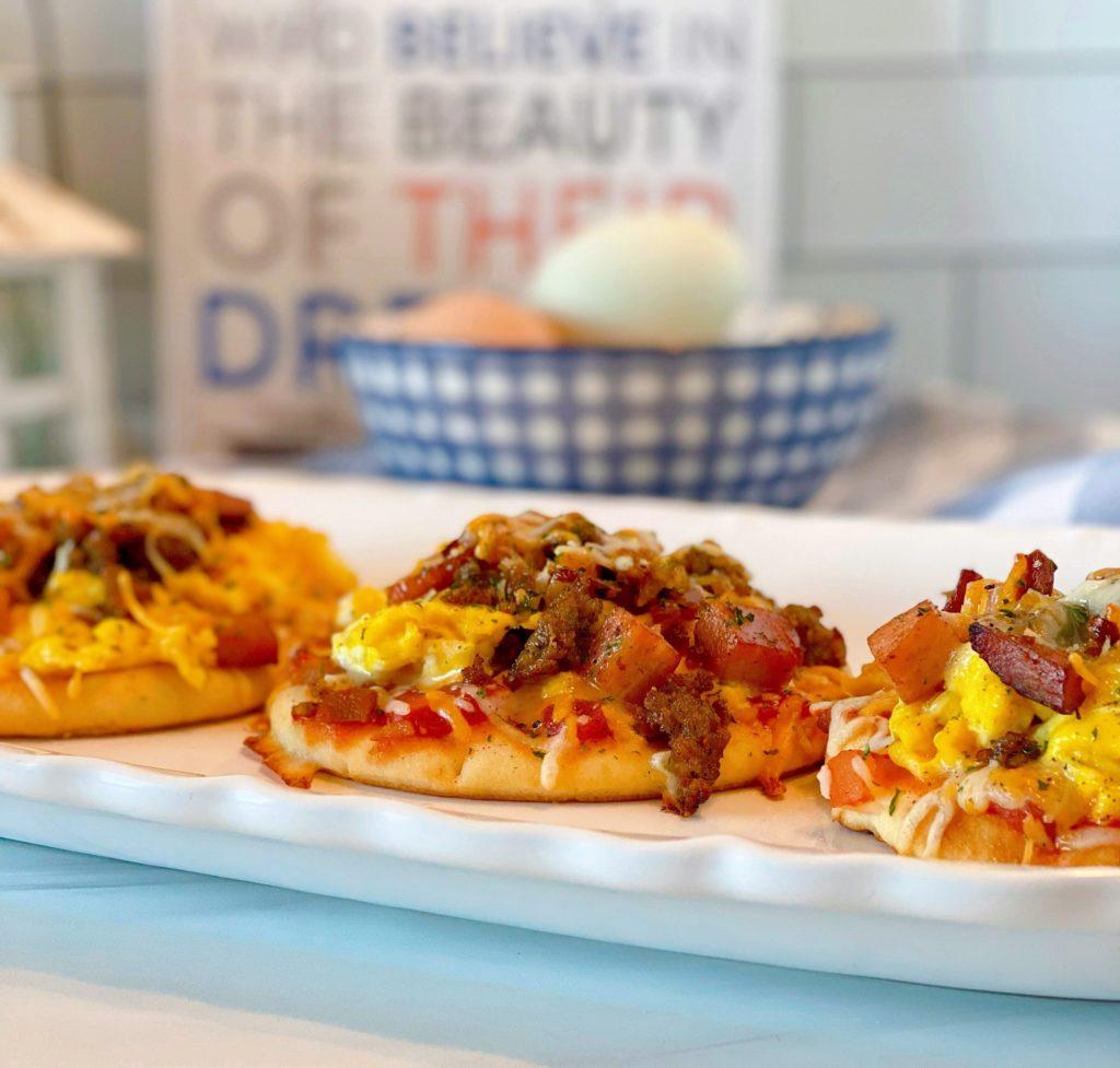 Breakfast pizzas on a platter.