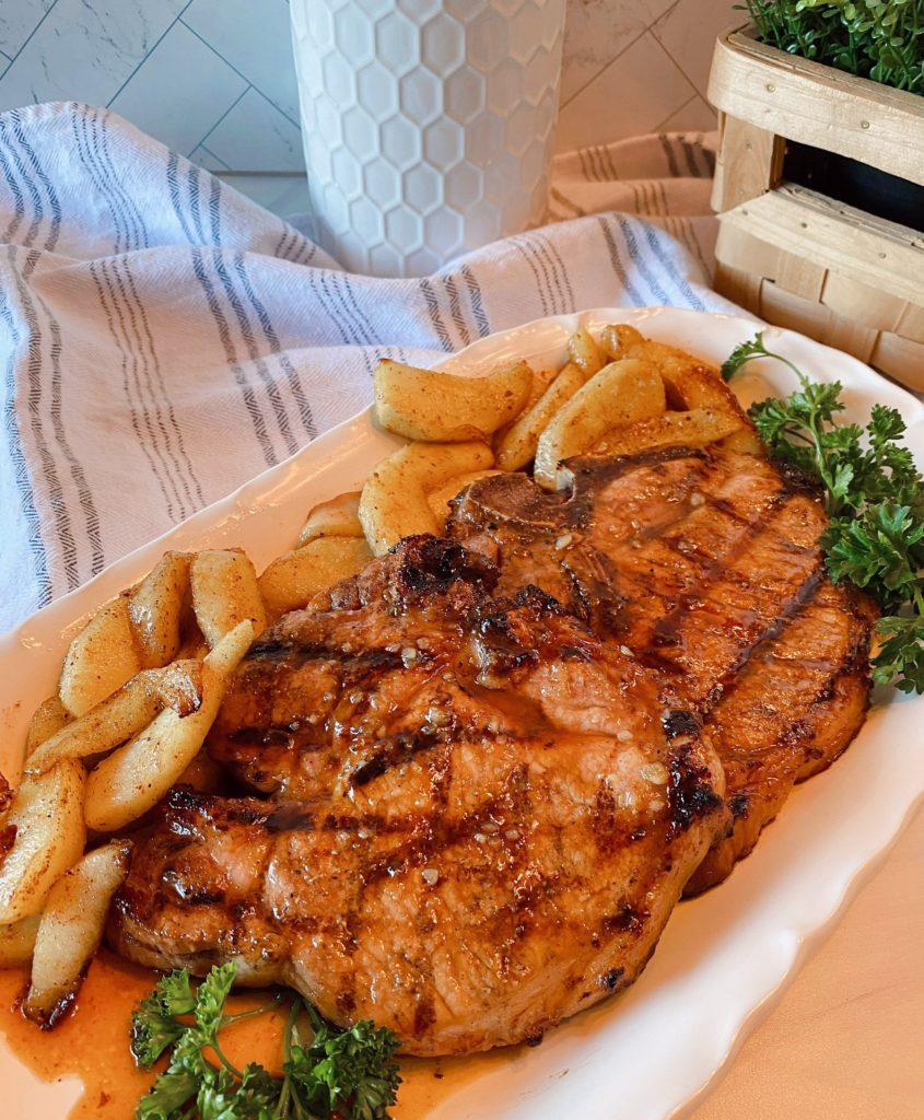 Grilled Pork Chops with Apple Slices and Honey Garlic Sauce.