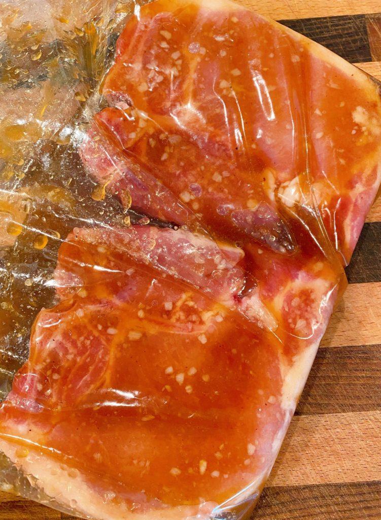Pork chops in a ziploc bag with marinade