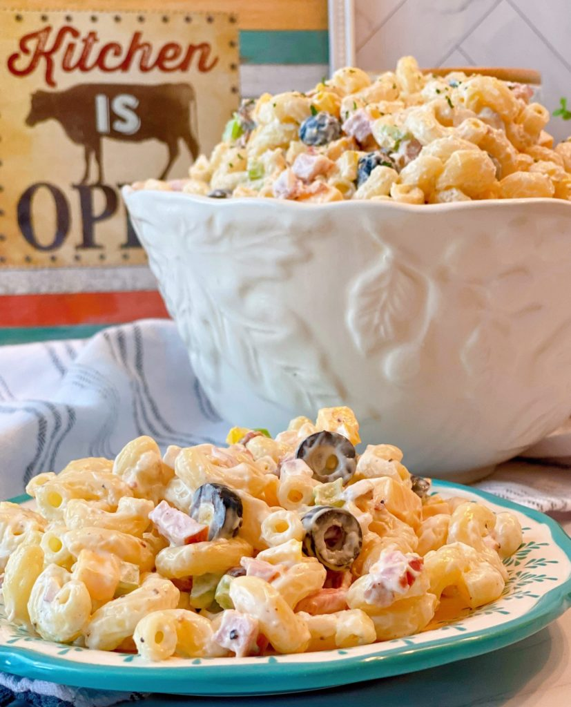 Creamy Summer Macaroni Salad in a large serving bowl and on a salad plate.