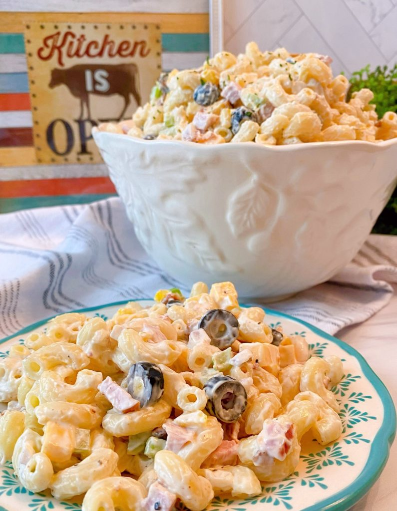 Creamy Summer Pasta Salad in a serving bowl and on a plate.