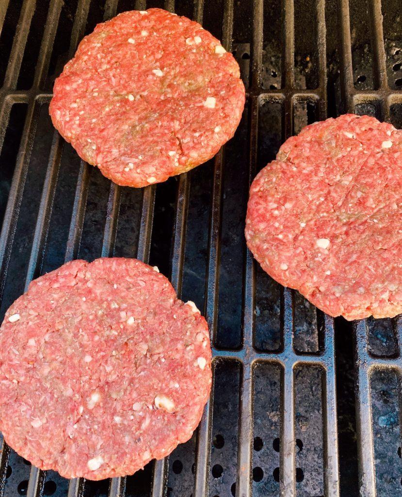 Hamburger patties on BBQ grill.