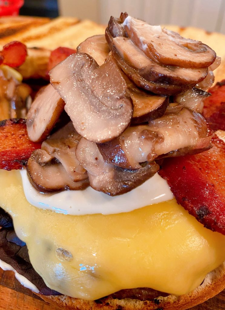 Mushrooms and shallots added to burger.