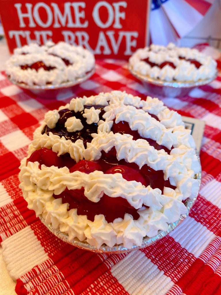 Mini No Bake Cheesecake Pies on a red checked clothed.