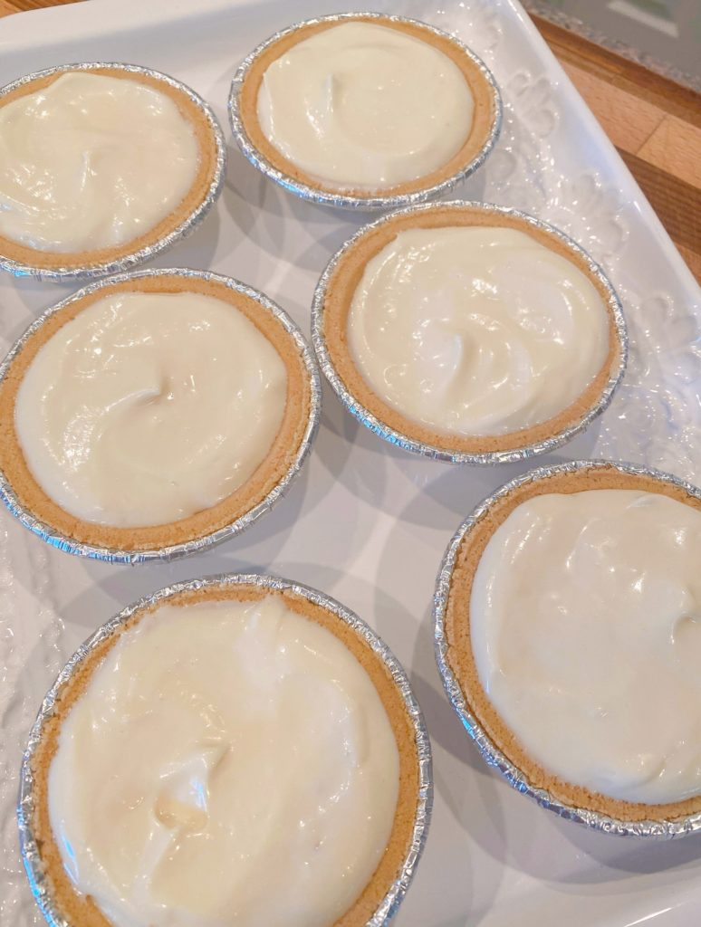 Mini no bake graham cracker pie crust filled with cream cheese filling.