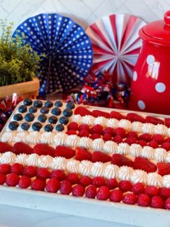 Red, White & Blue Poke Cake with Patriotic Background in a cake pan.